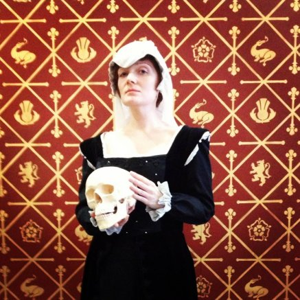 Posing with a skull