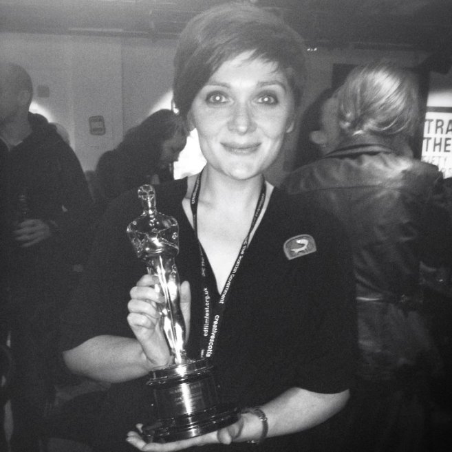 Posing with an Oscar (not mine)